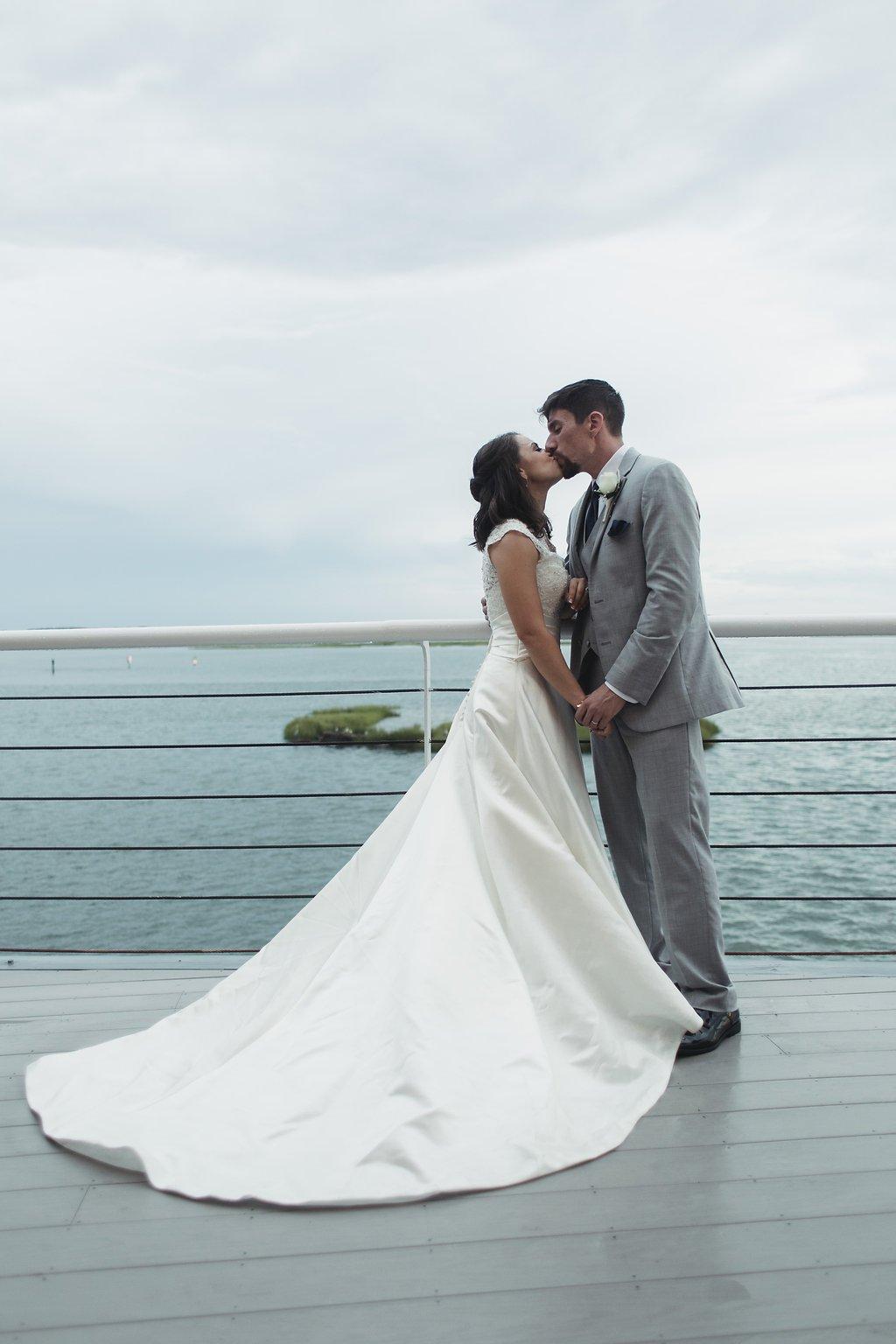 rainy-wedding-day-myth-best-wedding-photos-lesner-inn-virginia-beach-Sunset-Deck